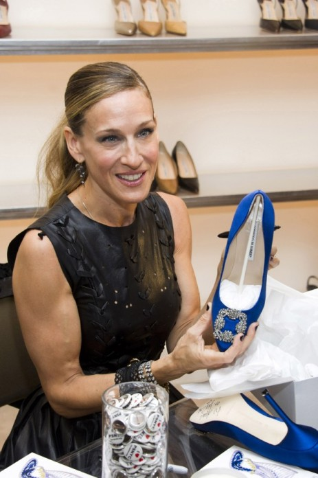 Foreshadowing of whats to come? SJP holding the famous Manolo Blahnik, from the SATC movie, at a Fashion's Night Out event in 2011.
