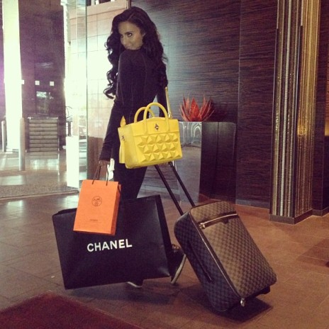 Shahs of Sunset star Lily Ghalichi posing with her vibrant yellow Classic Shield!