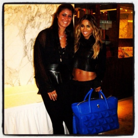 Ciara posing with her blue Classic Shield and the designer Sofia Al Asfoor!